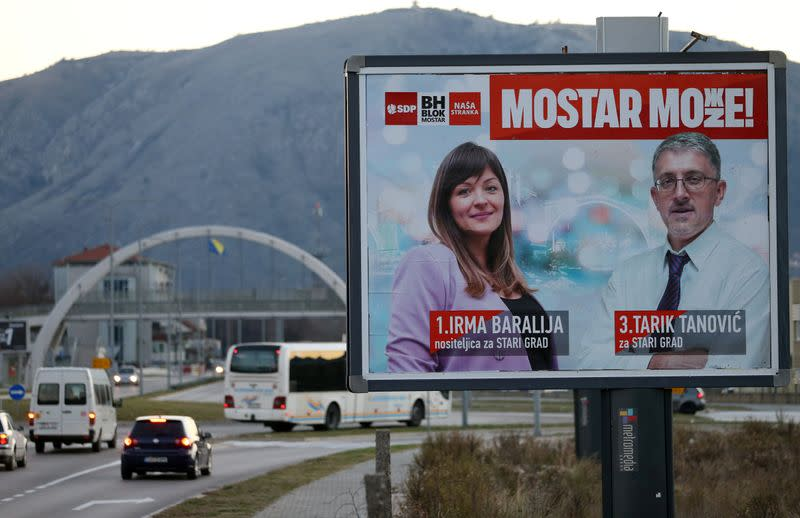 The image of Irma Baralija, a philosophy teacher and politician, is seen in an election sign, in Mostar