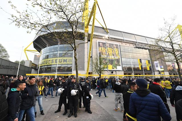 <p>Police officers and fans stand in front of the Signal Iduna Park in Dortmund, Germany, Tuesday, April 11. The first leg of the Champions League quarter final soccer match between Borussia Dortmund and AS Monaco had been cancelled to an explosion. (AP Photo/Bernd Thissen/dpa via AP </p>