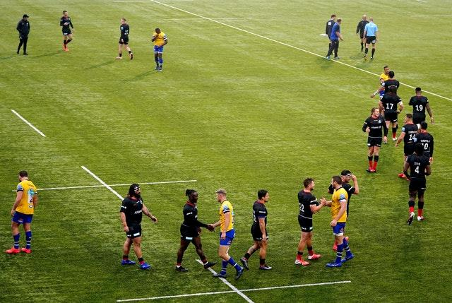 Saracens and Bath players shake hands at the end of the match