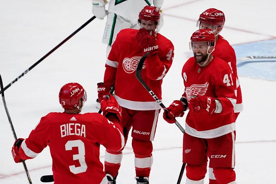 (From left) Red Wings defenseman Alex Biega and forwards Darren Helm, Luke Glendening and Richard Panik (24) celebrate a goal scored by Glendening in the second period on Monday, April 19, 2021, in Dallas.
