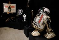 A R2-S8 droid from the Star Wars film, Solo: A Star Wars Story, is seen at a preview of a movie and TV memorabilia auction in Rickmansworth
