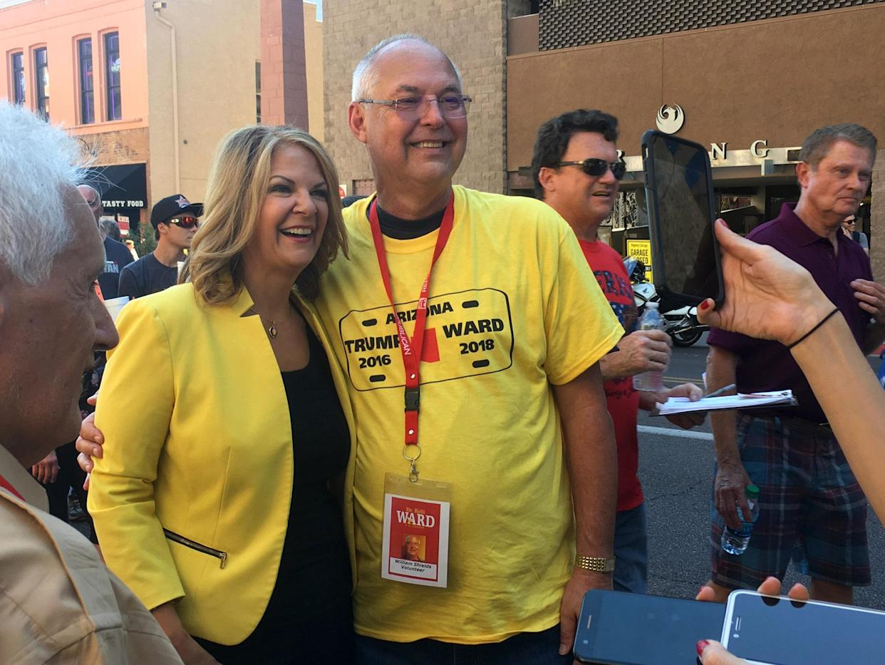 Right-wing Flake challenger Kelli Ward poses with a supporter outside President Trump's Aug. 22 rally in Phoenix. (Photo: Andrew Romano/Yahoo News)