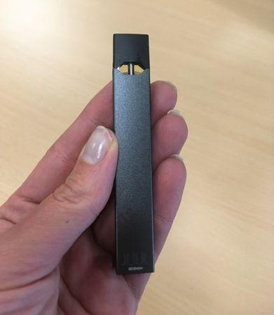 Juul e-cigarette is seen in this picture illustration taken July 16, 2018. REUTERS/Martinne Geller/Illustration