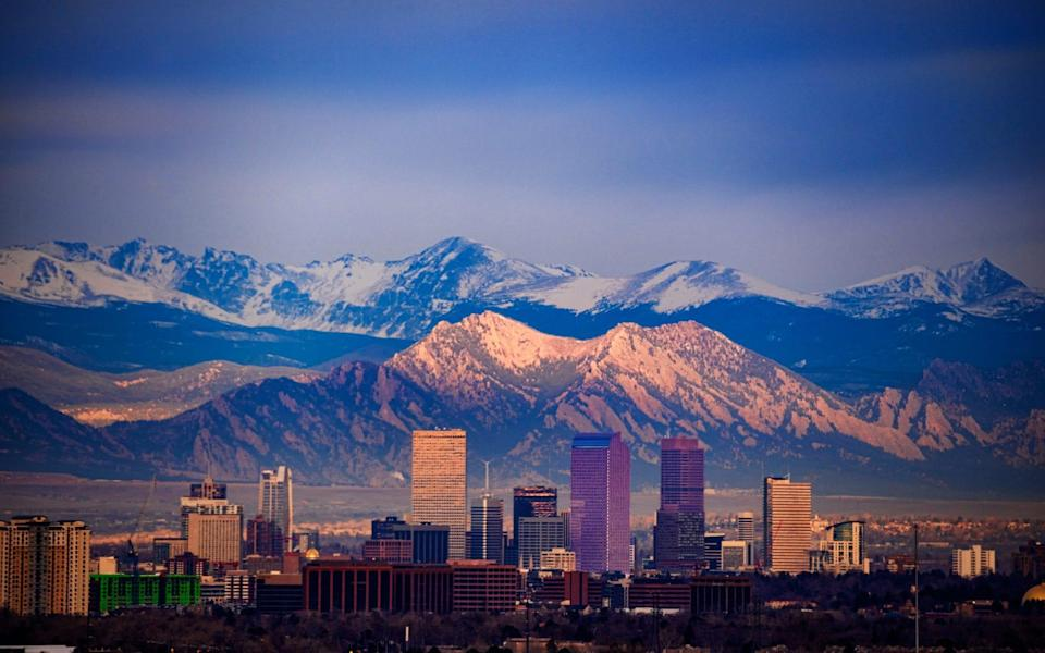 Colorado - Getty/Cityscape of downtown Denver with the Flatirons and Longs Peak in the background