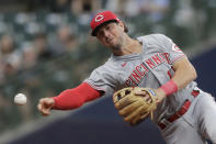 Cincinnati Reds' Kyle Farmer throws out Milwaukee Brewers' Avisail Garcia at first base during the third inning of a baseball game Monday, June 14, 2021, in Milwaukee. (AP Photo/Aaron Gash)