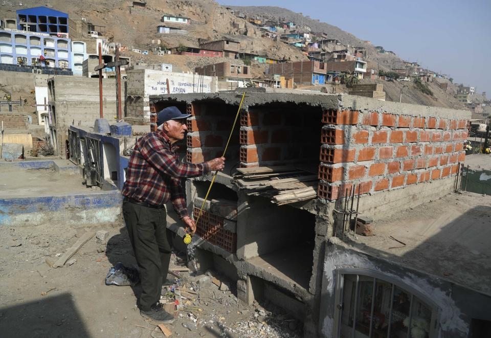 Victor Coba measures the graves he is building for himself and his family in Peru.