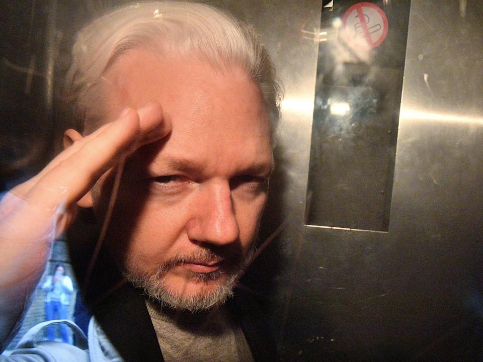 Assange, pictured in 2019 from the window of a prison vanAFP via Getty Images