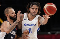 Czech Republic's Blake Schilb (11) passes under pressure from France's Evan Fournier (10) during a men's basketball preliminary round game at the 2020 Summer Olympics in Saitama, Japan, Wednesday, July 28, 2021. (AP Photo/Charlie Neibergall)
