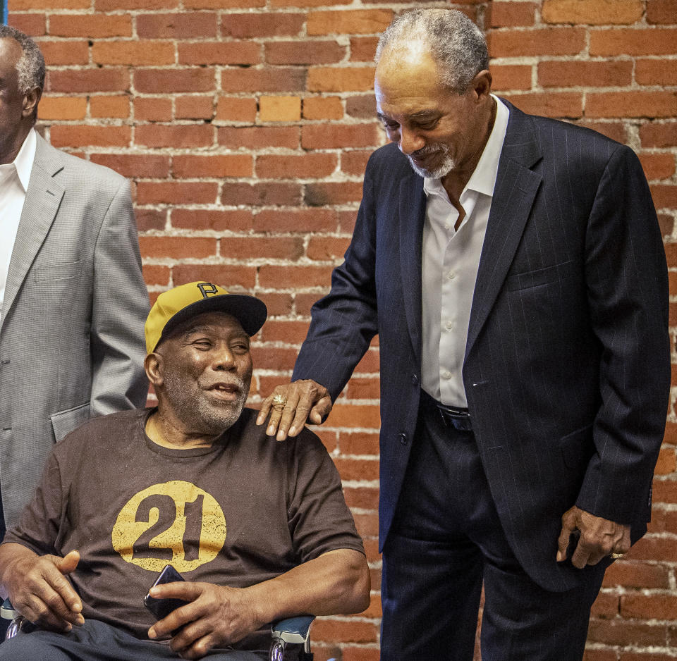Manny Sanguillen, left, and Dave Cash talk during an event hosted by the Pittsburgh Pirates to honor the 50th anniversary of the first all-minority lineup to take the field in Major League Baseball history, at the Heinz History Center, Wednesday, Sept. 1, 2021, in Pittsburgh. (Alexandra Wimley/Pittsburgh Post-Gazette via AP)
