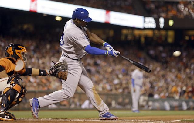 Los Angeles Dodgers' Yasiel Puig connects for a two-run triple off San Francisco Giants' Tim Lincecum in the fifth inning of a baseball game Friday, July 25, 2014, in San Francisco. (AP Photo)