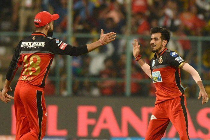 Chahal and Kohli after picking up a wicket (Picture Courtesy-BCCI/iplt20.com)