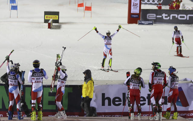 Switzerland's Ramon Zenhaeusern, center, celebrates as Switzerland wins the team event, at the alpine ski World Championships in Are, Sweden, Tuesday, Feb. 12, 2019. (AP Photo/Alessandro Trovati)