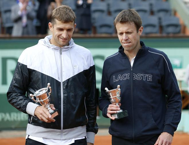 Belarus Max Mirnyi (L) and Canada's Daniel Nestor pose with a trophy after wining over US Bob Bryan and US Mike Bryan during Men's Doubles final tennis match of the French Open tennis tournament at the Roland Garros stadium, on June 9, 2012 in Paris.  AFP PHOTO / THOMAS COEXTHOMAS COEX/AFP/GettyImages
