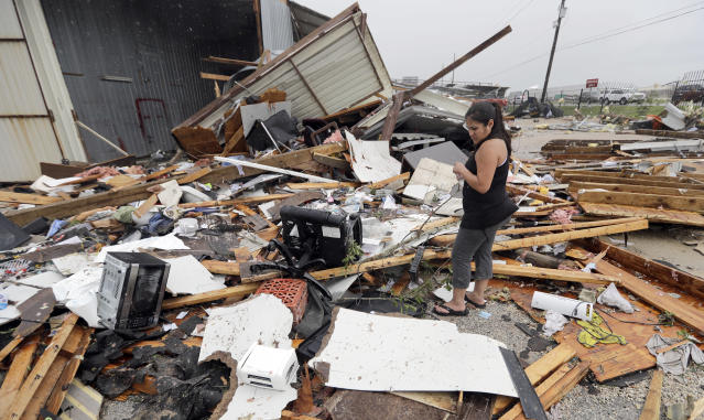 <p>Jennifer Bryant looks over the debris from her family business destroyed by Hurricane Harvey Saturday, Aug. 26, 2017, in Katy, Texas. (Photo: David J. Phillip/AP) </p>