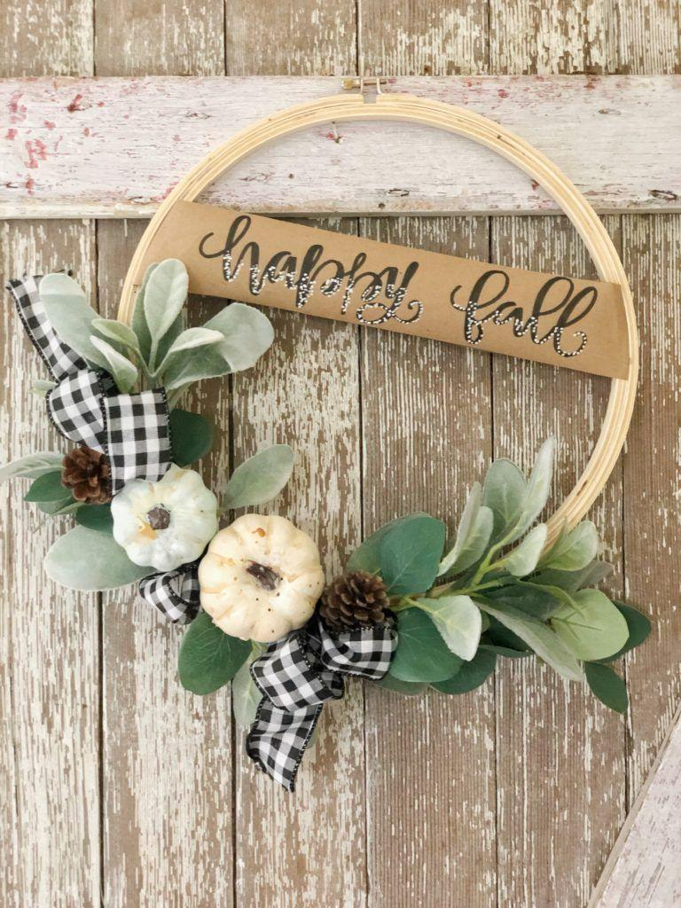 """<p>This simple, yet gorgeous, wreath only take a few steps to make, and the unexpected green hue is a lovely touch for autumn.</p><p><strong>Get the tutorial at <a href=""""https://www.thepickledrose.com/fall-hoop-wreath-diy/"""" rel=""""nofollow noopener"""" target=""""_blank"""" data-ylk=""""slk:The Pickled Rose"""" class=""""link rapid-noclick-resp"""">The Pickled Rose</a>.</strong> </p>"""