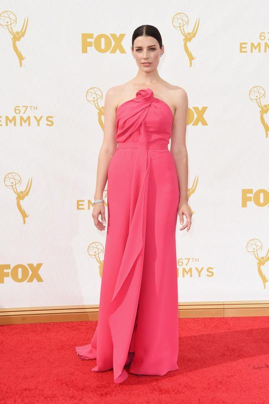 """<p>Jessica Pare basically became Megan Draper at the Emmys. Blurring the lines between real life and """"Mad Men,"""" the actress looked divine in a hot pink gown with a rose at the chest. </p>"""