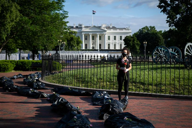 Demonstrators display fake body bags in protest of the Trump administration's response to the coronavirus pandemic. Source: Getty