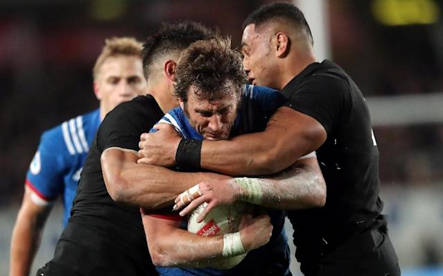 France's Maxime Medard is tackled by New Zealand's Anton Lienert-Brown (L) and Ngani Laumape during their first rugby union Test match, at Eden Park in Auckland, on June 9, 2018 (AFP Photo/MICHAEL BRADLEY)