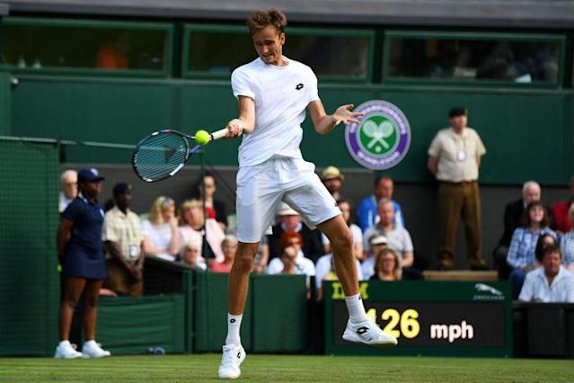 Daniil Medvedev took out his wallet and threw coins on the court afterhis second round defeat. (Getty Images)