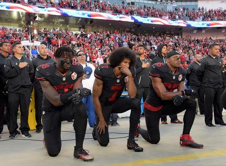 San Francisco 49ers outside linebacker Eli Harold (58), quarterback Colin Kaepernick (7) and free safety Eric Reid (35) kneel in protest during the playing of the national anthem before a NFL game against the Arizona Cardinals in Santa Clara, California, Oct 6, 2016.   Mandatory Credit: Kirby Lee-USA TODAY Sports/File Photo