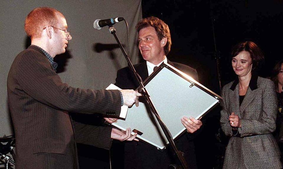 Then Labour leader Tony Blair receives a platinum disc of Oasis's album 'What's The Story, Morning Glory' from Alan McGhee of Creation Records in 1997.