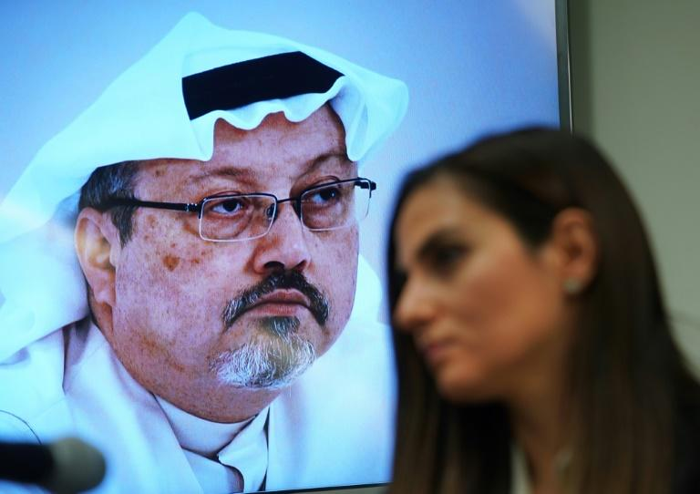This 2018 picture shows Sherine Tadros of rights group Amnesty International before an image of Saudi journalist Jamal Khashoggi (AFP Photo/TIMOTHY A. CLARY)