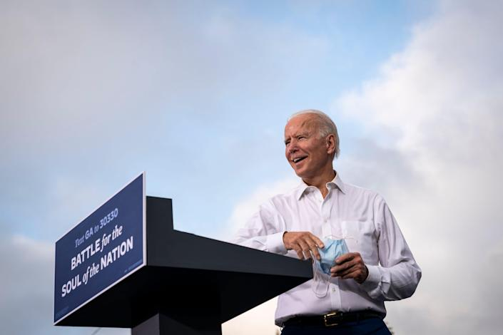 Democratic presidential nominee Joe Biden  campaigns at a drive-in rally in the parking lot of Cellairis Amphitheatre on Oct. 27, 2020, in Atlanta.