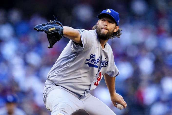 Los Angeles Dodgers starting pitcher Clayton Kershaw throws a pitch against the Arizona Diamondbacks during the first inning of a baseball game Saturday, Sept. 25, 2021, in Phoenix. (AP Photo/Ross D. Franklin)