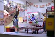 The miniature recreations are painstakingly detailed, meant to preserve the past of fast-changing Hong Kong