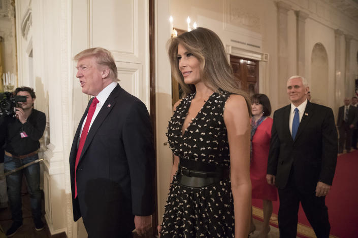<p>U.S. President Donald J. Trump (Front L), First Lady Melania Trump (Front R), US Vice President Mike Pence (Back R) and his wife Karen Pence (Back L) enter the East Room from the Cross Hall to attend an event hosting participants of the Wounded Warrior Project Soldier Ride, at the White House in Washington, D.C., April 6, 2017. A cycling event to help Wounded Warriors restore their physical and emotional well-being, the Soldier Ride also raises awareness of US veterans who battle the physical and psychological damages of war. (Photo: Michael Reynolds/EPA) </p>