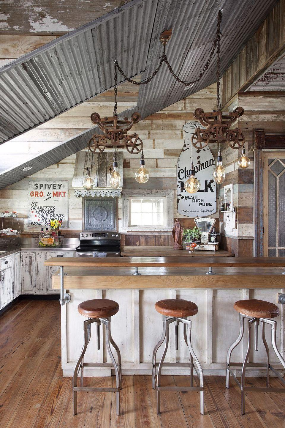 "<p>To us, <a href=""https://www.countryliving.com/home-design/decorating-ideas/g4031/vintage-decor-ideas-inspired-by-grandma/"" rel=""nofollow noopener"" target=""_blank"" data-ylk=""slk:vintage will always be in"" class=""link rapid-noclick-resp"">vintage will always be in</a>. The owners of this <a href=""https://www.countryliving.com/home-design/house-tours/g22853062/old-world-antieks-rustic-farmhouse-tour/"" rel=""nofollow noopener"" target=""_blank"" data-ylk=""slk:Texas farmhouse"" class=""link rapid-noclick-resp"">Texas farmhouse</a> show their love of repurposed pieces with matching reclaimed pine throughout the home.</p><p><a class=""link rapid-noclick-resp"" href=""https://www.amazon.com/s?k=reclaimed+wood&ref=nb_sb_noss&tag=syn-yahoo-20&ascsubtag=%5Bartid%7C10050.g.3988%5Bsrc%7Cyahoo-us"" rel=""nofollow noopener"" target=""_blank"" data-ylk=""slk:SHOP RECLAIMED WOOD"">SHOP RECLAIMED WOOD</a></p>"