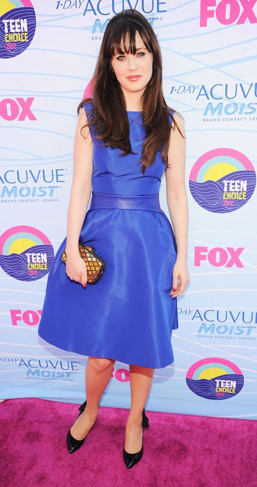 Actress Zooey Deschanel arrives at the 2012 Teen Choice Awards at Gibson Amphitheatre on July 22, 2012 in Universal City, California.