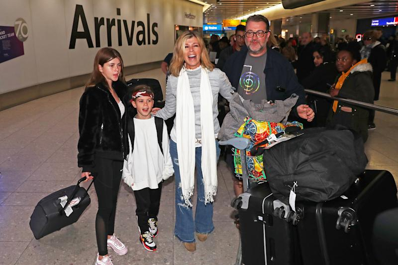 Kate Garraway, alongside her husband Derek Draper and two children Darcey, 13 and Bill, 10, returns to Heathrow airport after the 2019 series of I'm A Celebrity ... Get Me Out Of Here! (Photo by Steve Parsons / PA Images via Getty Images)