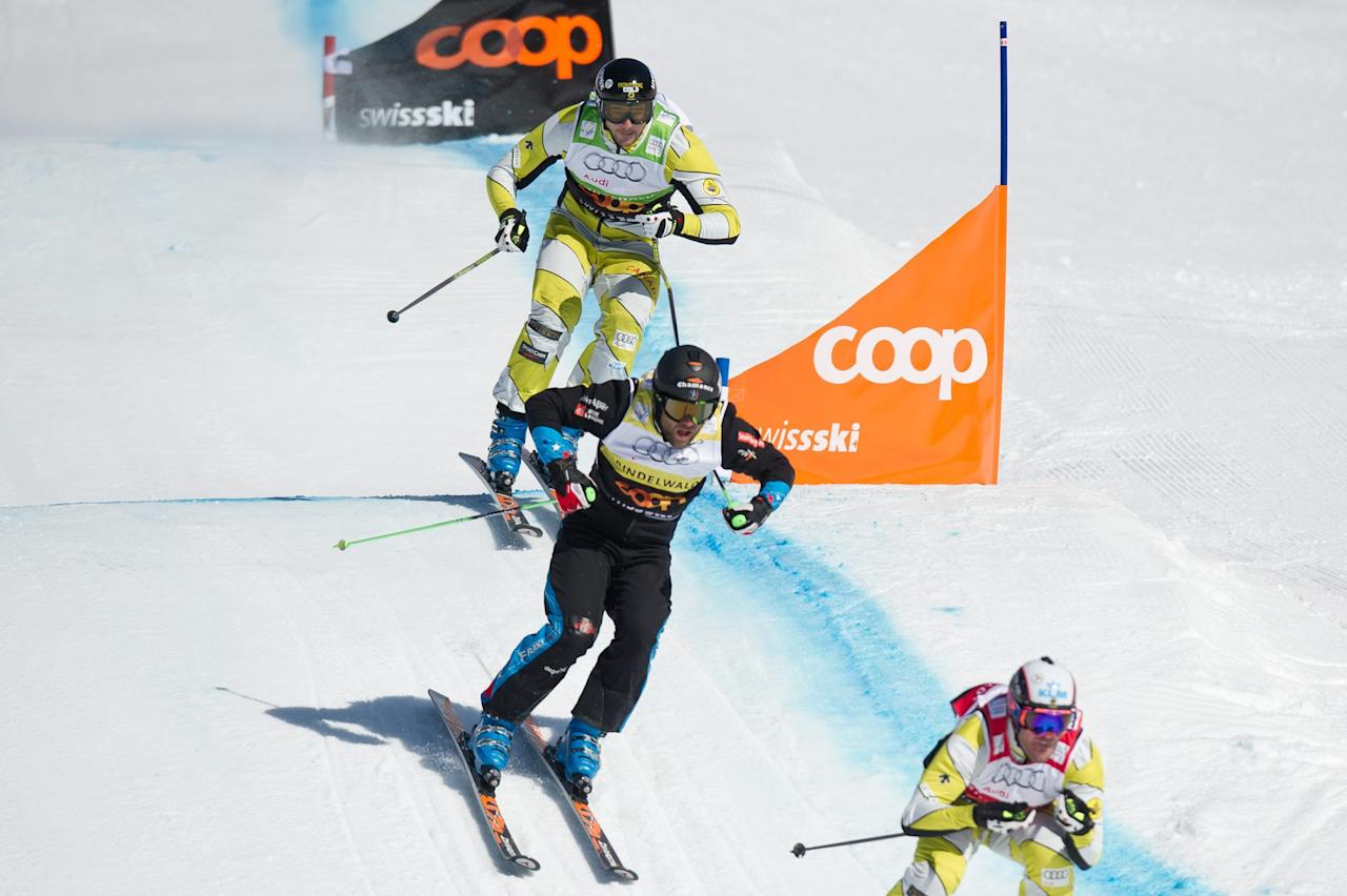 Canada`s Christopher Delbosco, France`s Jonas Devouassouk and Canada`s Nick Zoricic, from right, speed down during the skicross world cup finals, Saturday March 10, 2012 in Grindelwald Switzerland . The race has been cancelled after Zoricic heavily crashed. (AP Photo/Keystone/Samuel Truempy)