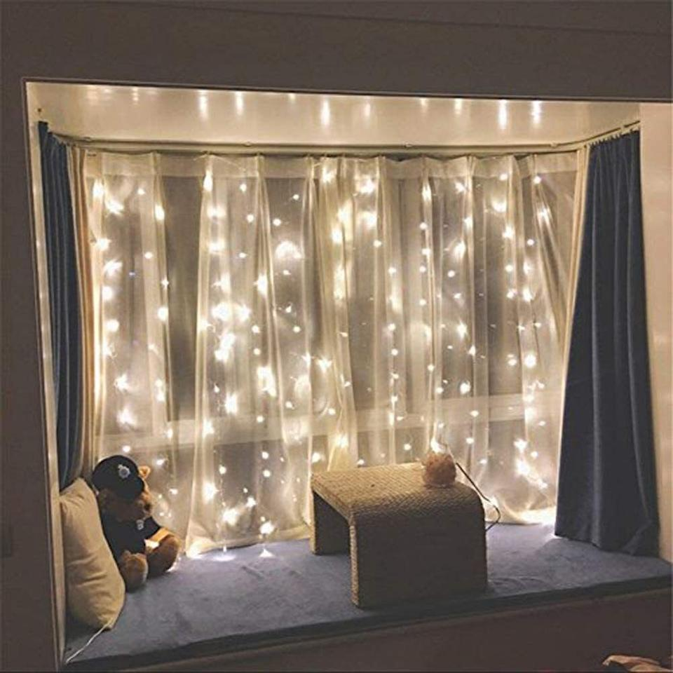 """Hang them on curtains to transform a dull room into a twinkling hangout spot.<br /><br /><strong>Promising review:</strong>""""These lights are a hit in our bedroom. I wanted vertical hanging lights on our 12-foot-high walls. Makes great ambience, and now our two kids want them in their rooms."""" —<a href=""""https://amzn.to/3v24vxl"""" target=""""_blank"""" rel=""""nofollow noopener noreferrer"""" data-skimlinks-tracking=""""5851345"""" data-vars-affiliate=""""Amazon"""" data-vars-href=""""https://www.amazon.com/gp/customer-reviews/RDKKYQ1HZ7OL4?tag=bfnusrat-20&ascsubtag=5851345%2C1%2C34%2Cmobile_web%2C0%2C0%2C16317666"""" data-vars-keywords=""""cleaning,fast fashion"""" data-vars-link-id=""""16317666"""" data-vars-price="""""""" data-vars-product-id=""""20939402"""" data-vars-product-img="""""""" data-vars-product-title="""""""" data-vars-retailers=""""Amazon"""">Raeanna<br /><br /></a><strong><a href=""""https://amzn.to/3fvC58v"""" target=""""_blank"""" rel=""""noopener noreferrer"""">Get it from Amazon for$15.28+ (available in two colors).</a></strong>"""