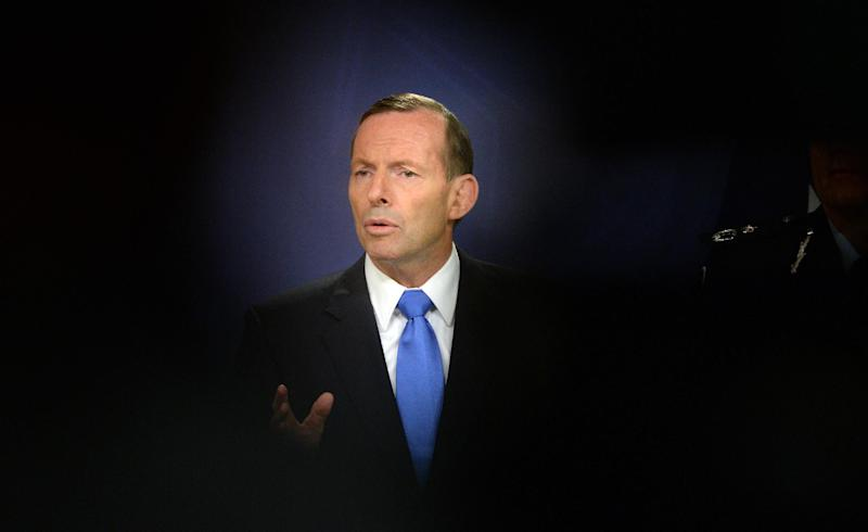 Australian Prime Minister Tony Abbott speaks during a press conference in Sydney on September 19, 2014 (AFP Photo/Saeed Khan)