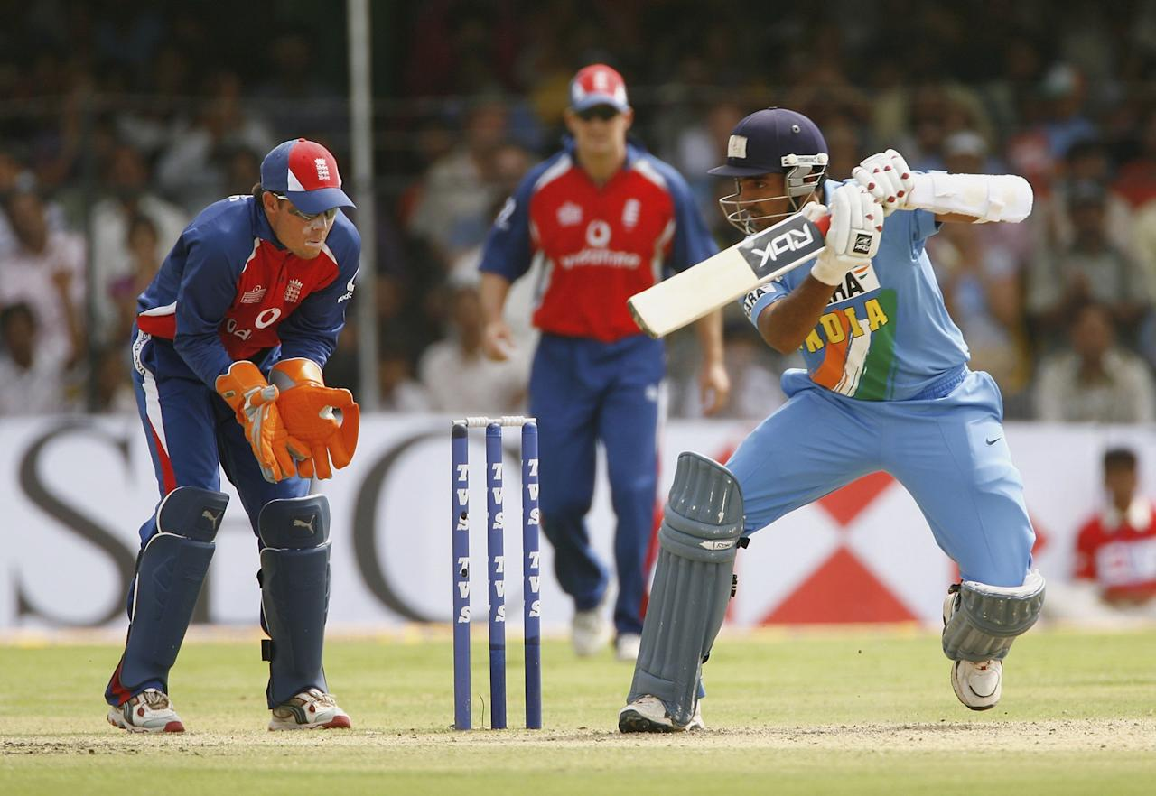 INDORE, INDIA - APRIL 15:  Robin Uthappa of India hits out during the 7th One Day International between India and England at the Usha Raje Cricket Ground on April 15, 2006 in Indore, India.  (Photo by Tom Shaw/Getty Images)