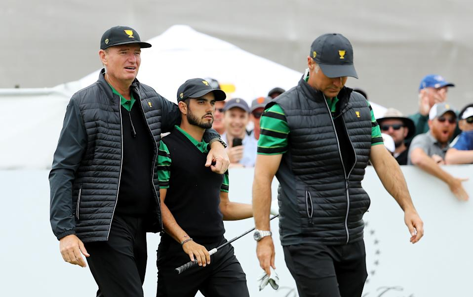 Ernie Els walks off with Abraham Ancer and co-captain Trevor Immelman. (Photo by Warren Little/Getty Images)