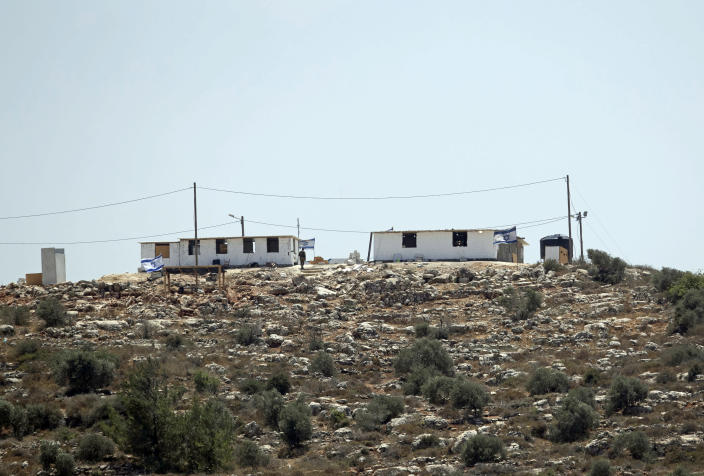 The the newly established Jewish outpost of Eviatar is seen from the Palestinian village of Beita, south of the West Bank city of Nablus, Monday, June 14, 2021. Israel's new government faces an early test in deciding whether to evacuate dozens of Israeli families from Eviatar, that was established last month without the permission of Israeli authorities on land the Palestinians say is privately owned. (AP Photo/Majdi Mohammed)