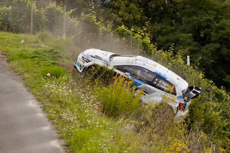 The car driven by French rallying world champion Sebastien Ogier and co-driver Julien Ingrassia comes off the road on the Moselland stage during the first part of the ADAC Rally Germany near Trier, western Germany, on August 22, 2014