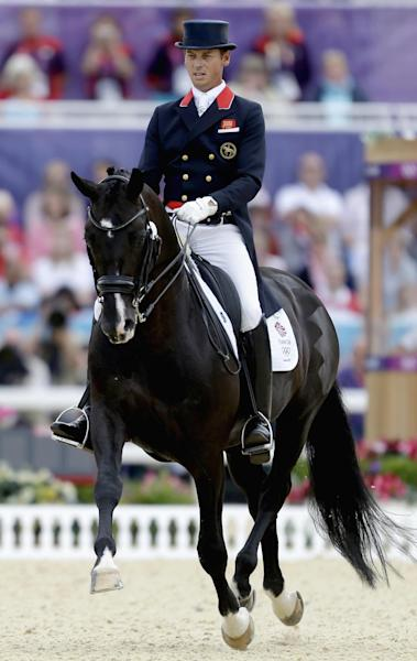 Carl Hester, of Great Britain, rides his horse Uthopia during the equestrian dressage competition at the 2012 Summer Olympics, Tuesday, Aug. 7, 2012, in London. (AP Photo/David Goldman)