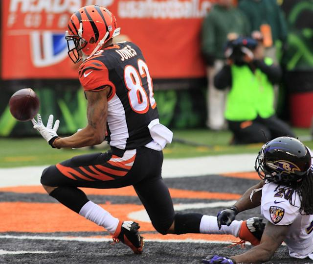 Cincinnati Bengals wide receiver Marvin Jones (82) catches a 16-yard touchdown pass against Baltimore Ravens cornerback Lardarius Webb (21) in the first half of an NFL football game on Sunday, Dec. 29, 2013, in Cincinnati. (AP Photo/Tom Uhlman)