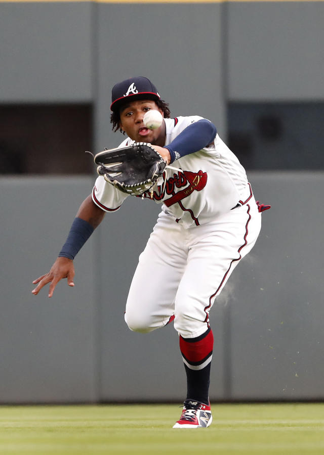 Atlanta Braves centerfielder Ronald Acuna Jr. (13) makes a running catch to retire San Diego Padres' Greg Garcia in the first inning of a baseball game Tuesday, April 30, 2019, in Atlanta. (AP Photo/John Bazemore)