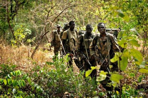 Ugandan soldiers patrol during an operation to fish out notorious Lord's Resistance Army leader Joseph Kony in April