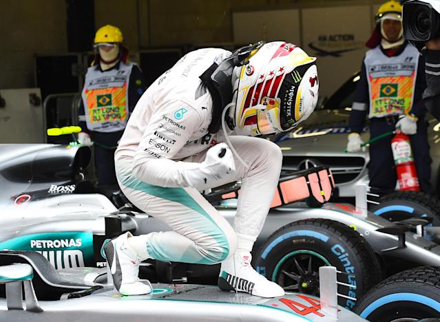 Mind the paintwork: Lewis Hamilton celebrates at the 2016 Brazilian Grand Prix, which he won from pole position
