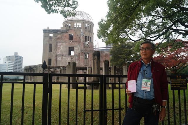 Kosei Mito, 71, an in-utero survivor of the atomic bombing of Hiroshima, volunteers as a tour guide in Hiroshima's Peace Memorial Park. (Photo: Michael Walsh/Yahoo News)
