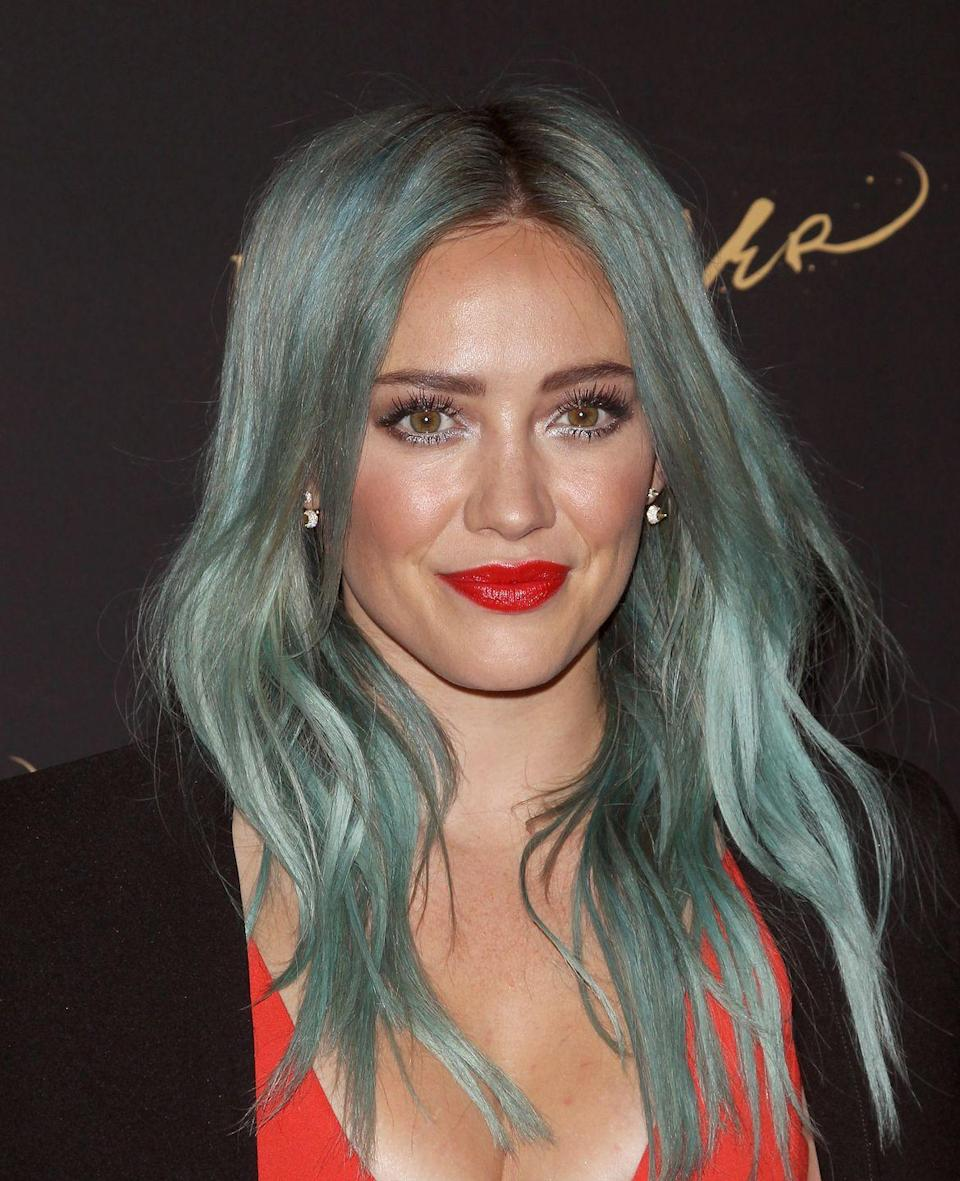 """<p>Being stuck indoors is giving us all kinds of ideas about crazy things to do to our hair. And Hilary Duff is right there with us! <a href=""""https://www.marieclaire.com/celebrity/a32125114/hilary-duff-blue-hair-bob/"""" rel=""""nofollow noopener"""" target=""""_blank"""" data-ylk=""""slk:She recently unveiled her quarantine-makeover"""" class=""""link rapid-noclick-resp"""">She recently unveiled her quarantine-makeover</a> that is giving us life. Her bright blue 'do is not something Duff hasn't tried before, but we can expect more ladies to test it out for themselves by August. This mermaid-esque look is channeling <em>Aquamarine</em> in the best possible way, and I can't wait to see my blue-haired belles at the summer cookout.</p>"""