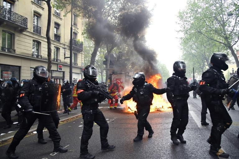 Some protesters in Paris smashed bank branch windows and set fire to dustbins