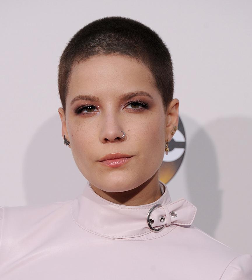 <p>Singer Halsey looked cool, calm, and collected at the 2016 American Music Awards with her deep brown shaved hair. (Photo: WireImage) </p>