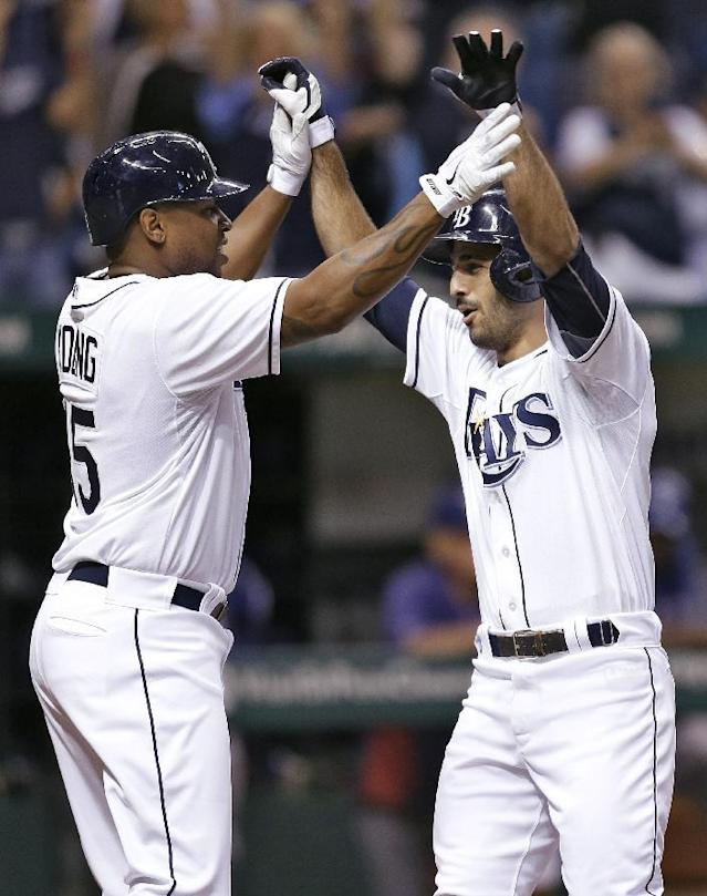 Tampa Bay Rays' Sean Rodriguez, right, celebrates with Delmon Young after hitting a sixth-inning, two run home run off Texas Rangers starting pitcher Derek Holland during an MLB American League baseball game Wednesday, Sept. 18, 2013, in St. Petersburg, Fla. (AP Photo/Chris O'Meara)